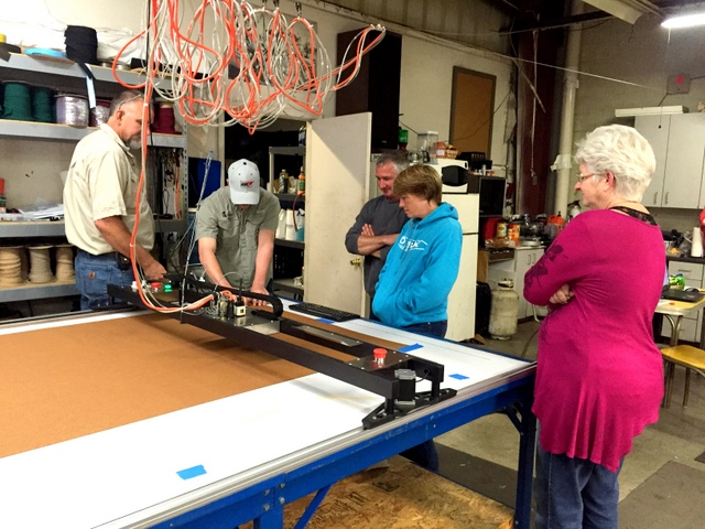 Billie is showing a neighboring Canvas shop how to cut with the Plotter/Cutter.
