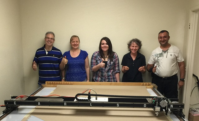 "The Cushion Cafe team gives a big ""Thumbs Up"" with their new Carlson Design PT-72"" Plotter/Cutter."