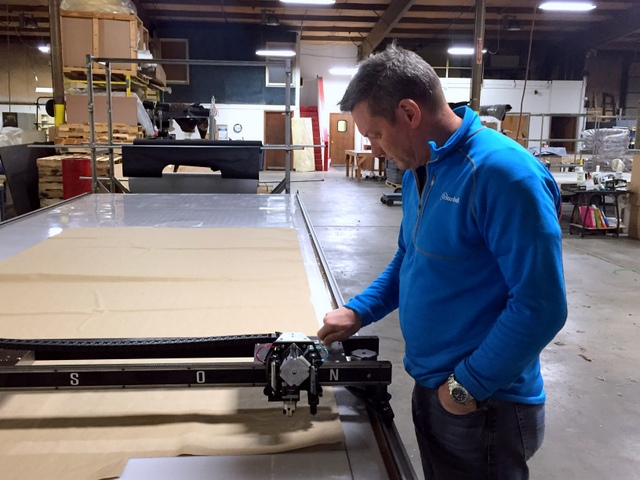 """Simple on-board controls make operating the Plotter/Cutter simple. The """"Operator's Panel"""" includes on/off, emergency stop, and clearly labeled pneumatic regulators for adjusting Plot/Cut pressure."""