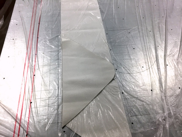 The elastic benefits from the sealed edge. The material is vacuum bagged during cutting to prevent shift.