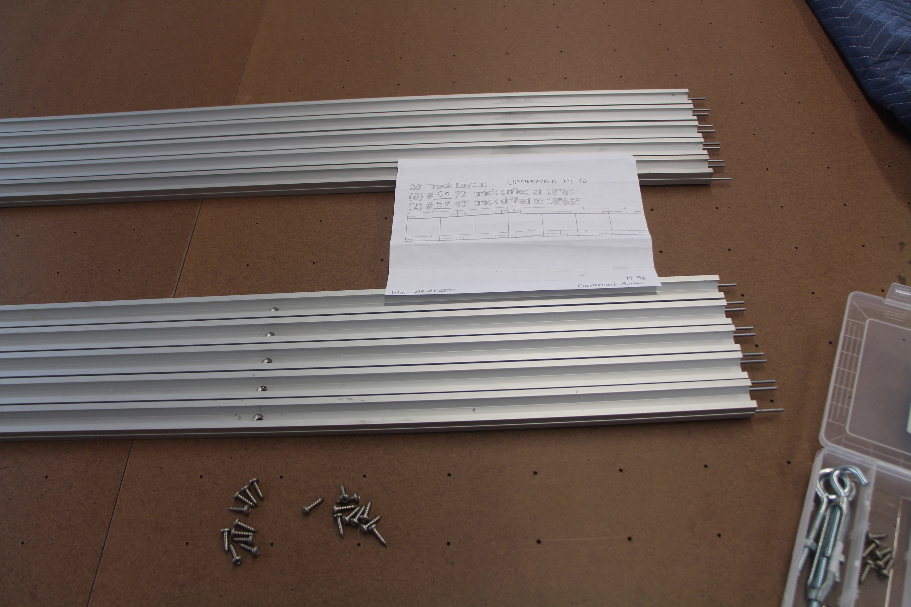 Carlson Design custom extruded aluminum track ready to be installed to the Phillocraft table.