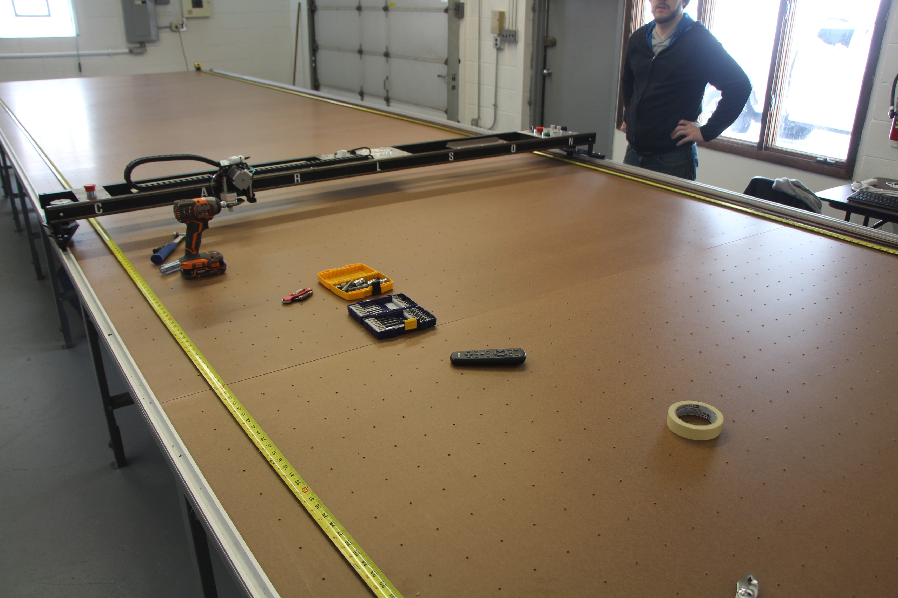 Once one side of table has track installed, we use the machine as a guide to set the track on the other side of the table.