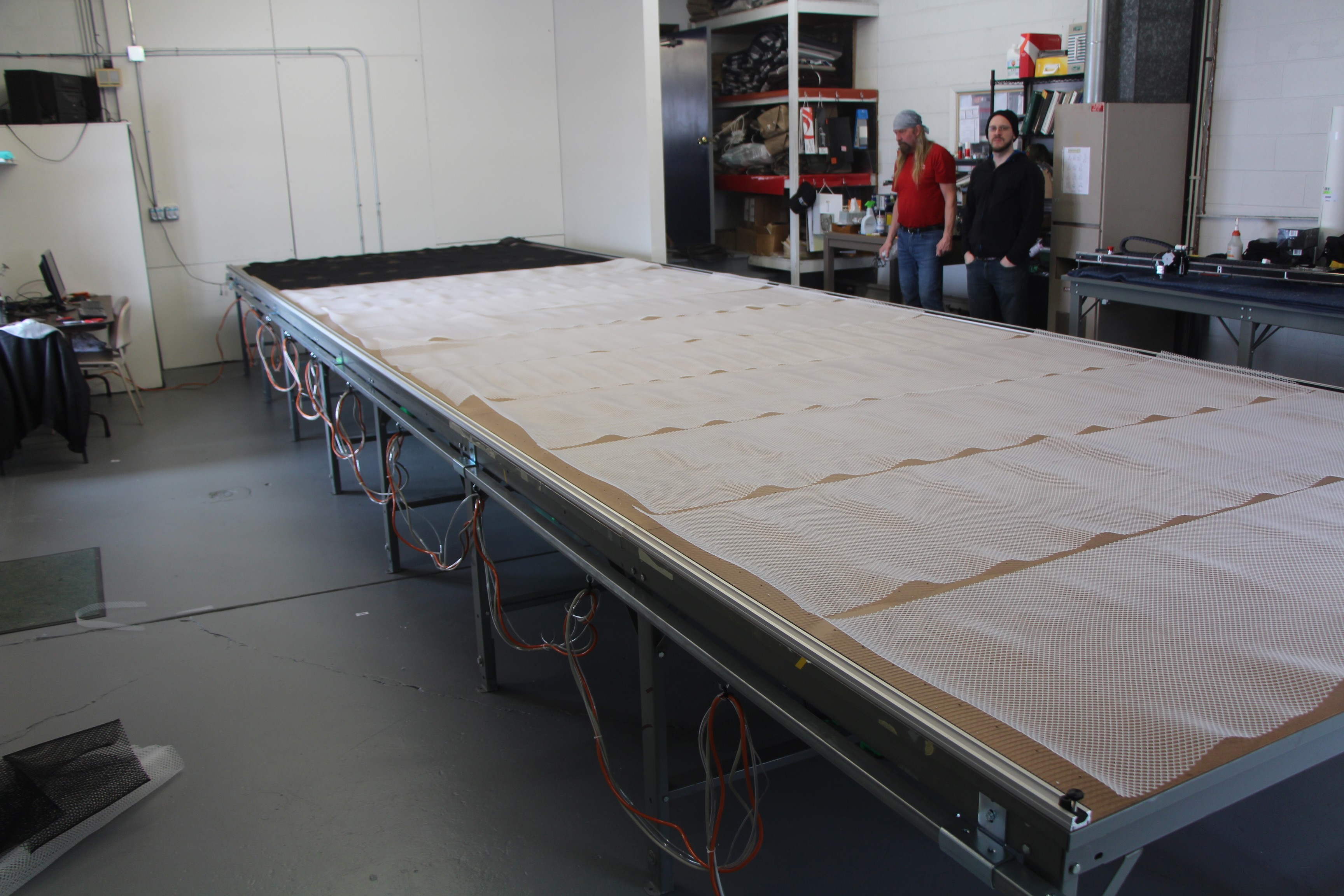 We are now ready for our cutting surface to be laid out and adhered to the table. Mesh is used to create an air gap for air to move across the top of the table surface and below our cutting surface.
