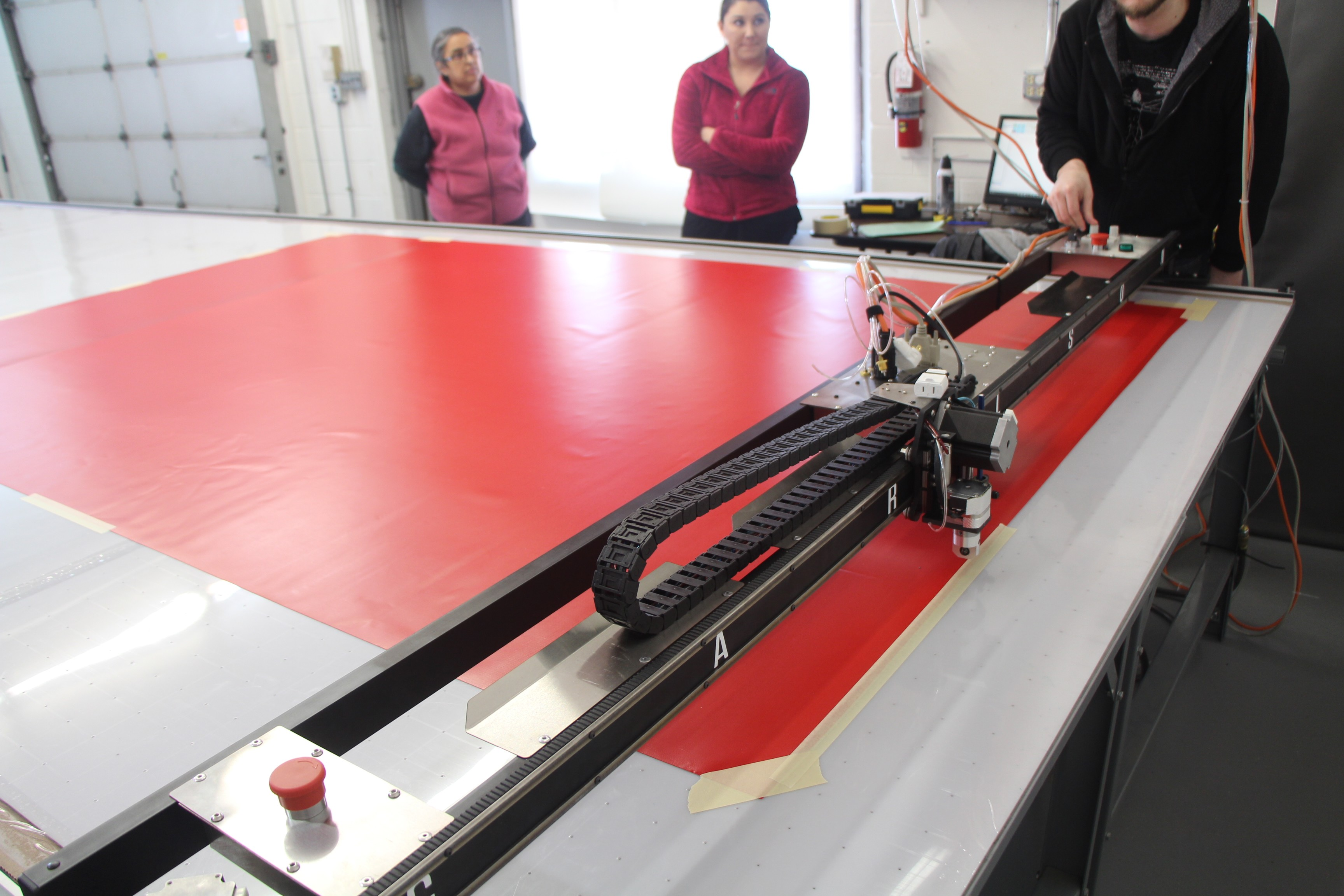 Once the machine is set on it's tracks, we start with a simple cut on some red vinyl. A basic triangle awning Matt prepared prior to install.