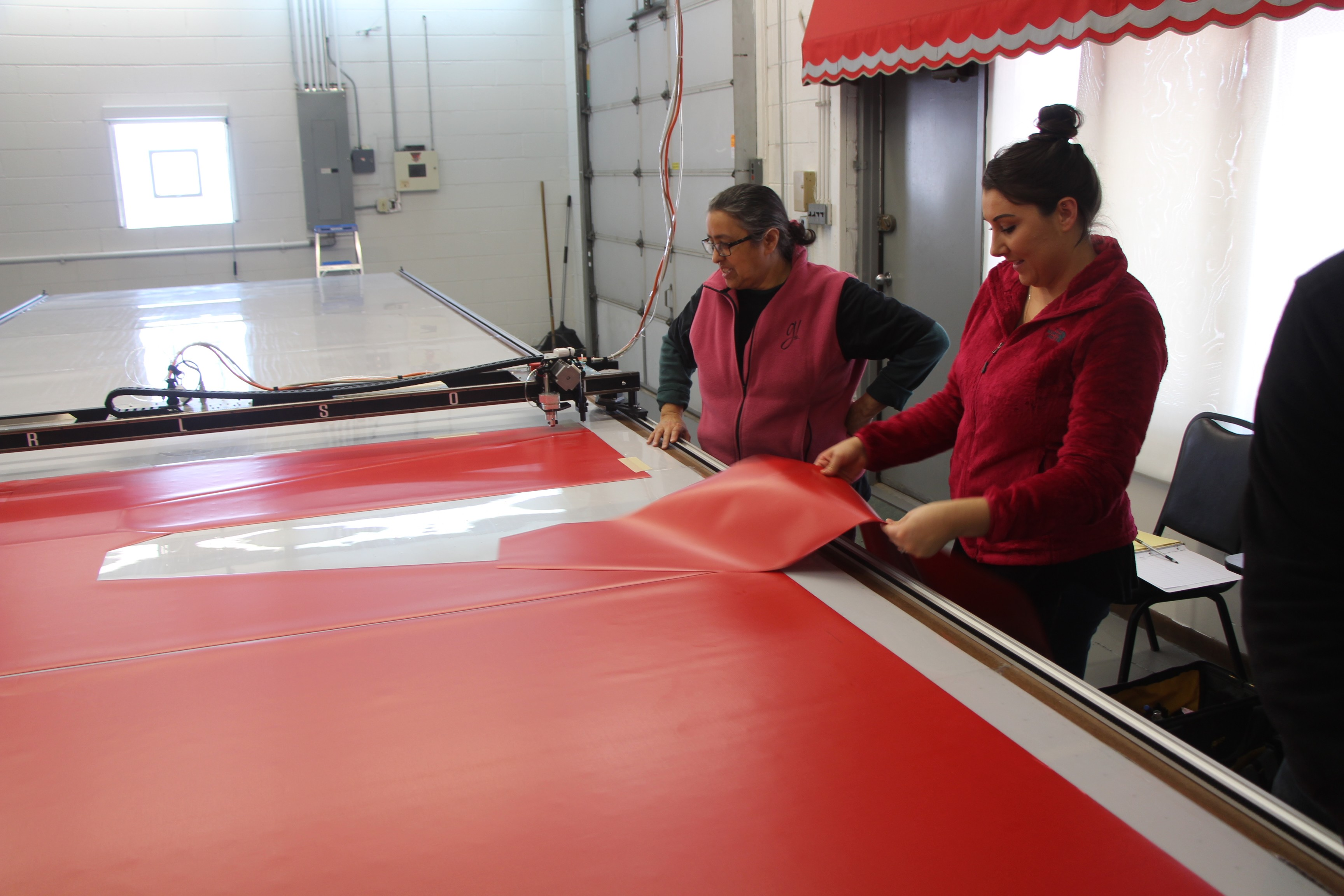 Inspecting the first cut. This is one wing of the awning.