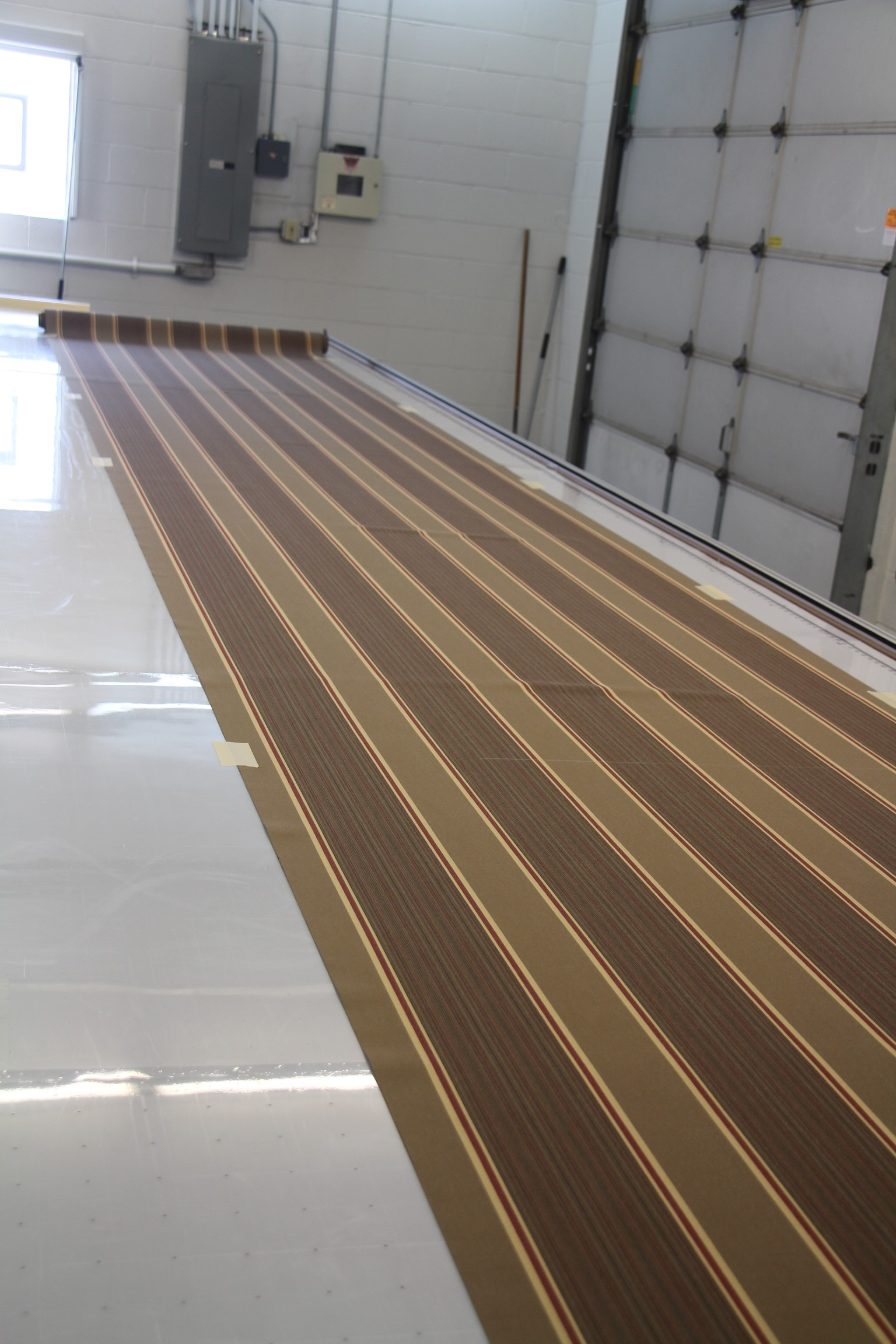 We now prepare to cut our pattern on some striped Sunbrella.