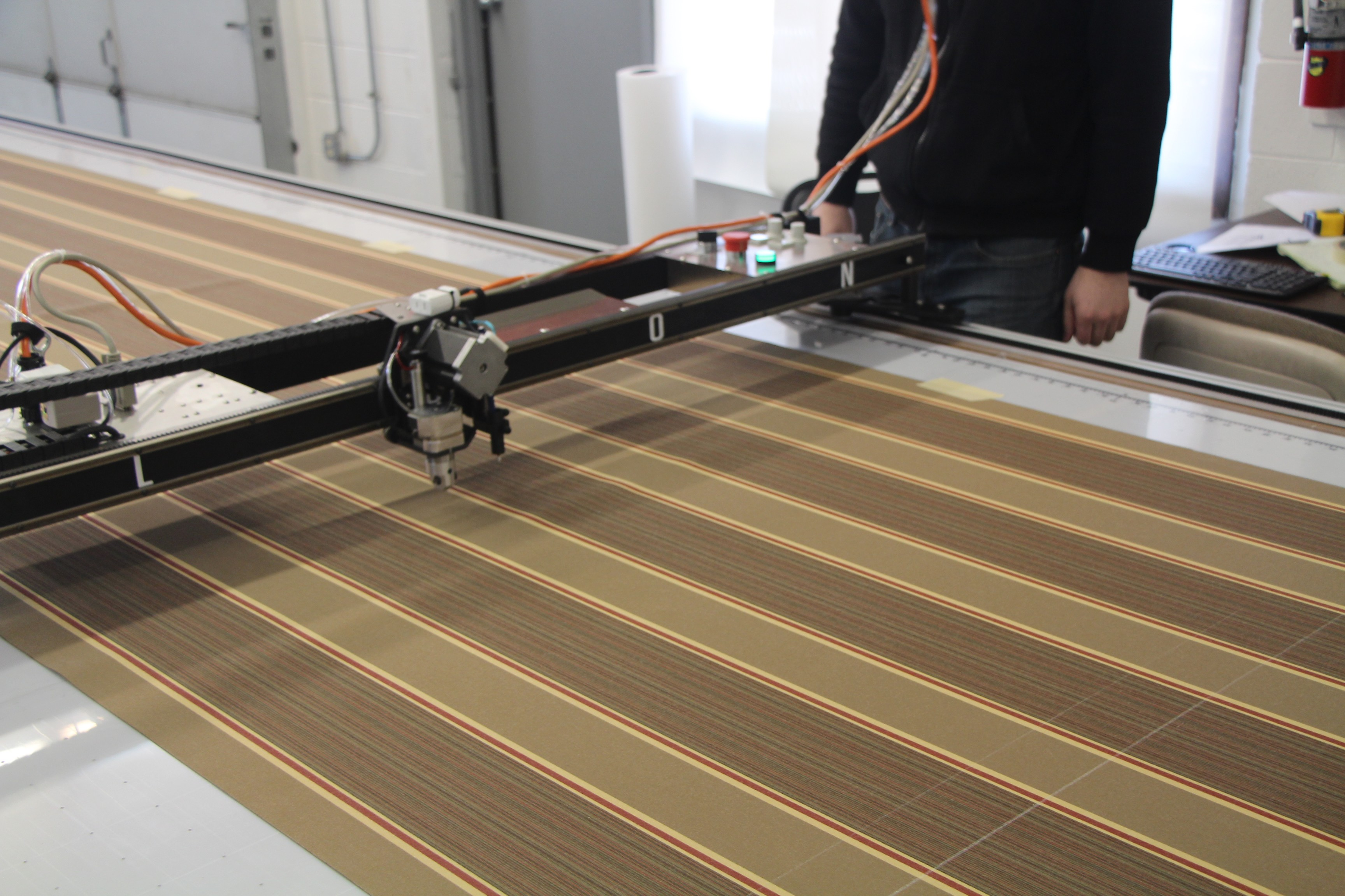 While nesting our pattern in Carlson Design's Plotmaster software, we account for the striped pattern and it's repeat.