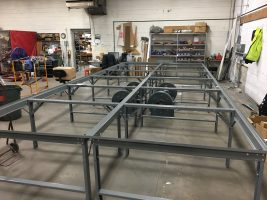 Erected 10'x24' Phillocraft steel-frame table.