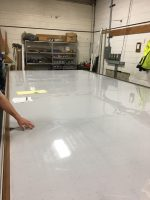 Cutting surface laid on top of the vacuum table tops and taped down.